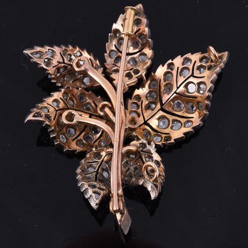 A diamond leaf brooch/pendant Une broche/pendentif en forme de feuille de diaman…