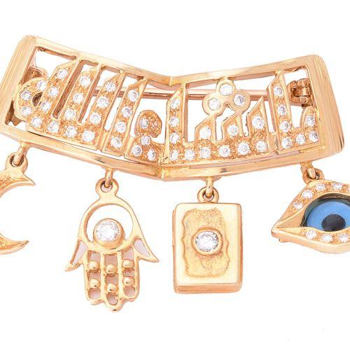 A Bismillah brooch retailed by Mouawad Boutique Une broche Bismillah vendue au d…