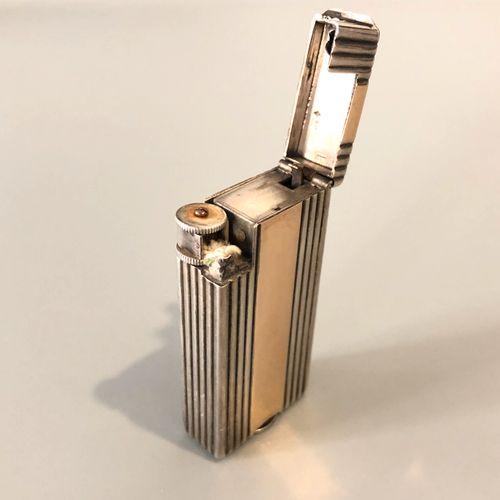 BOUCHERON Briquet à méche en argent (800 millièmes) doublé d'or 18K (750 millièm…