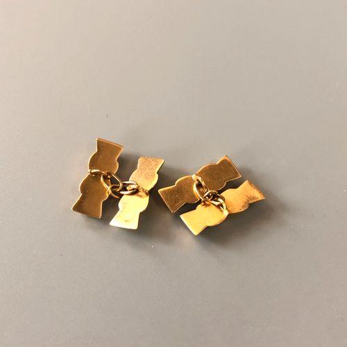Paire de boutons de manchettes en or jaune 18K (750 millièmes) godronné à motifs…