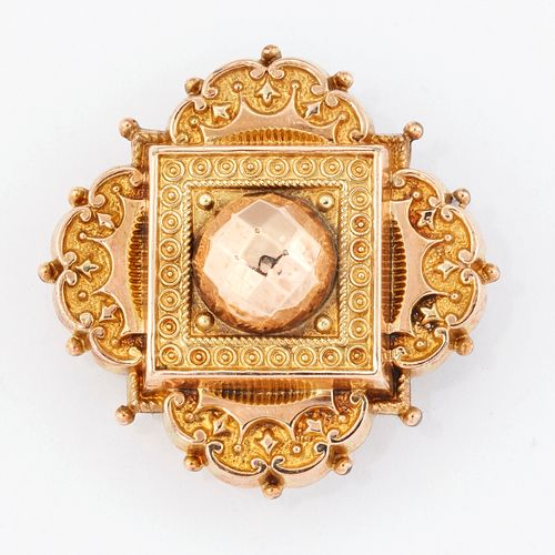 BROCHE DE RÉVOLUTION VICTORIENNE ETRUSCAN, de forme quadrilobée avec une décorat…