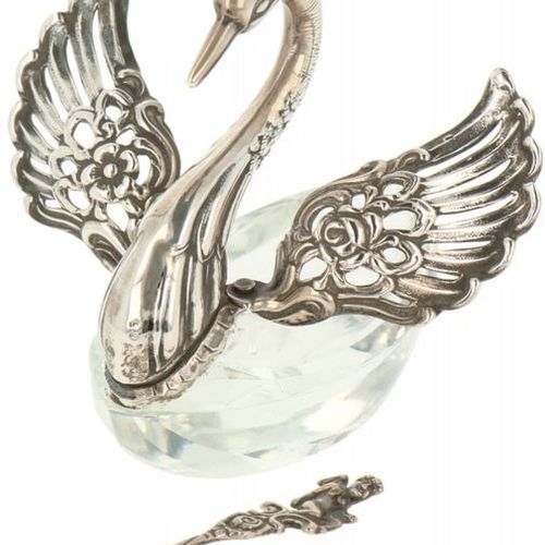 A salt cellar shaped as a swan with a spoon. Executed shaped as a swan with a cr…