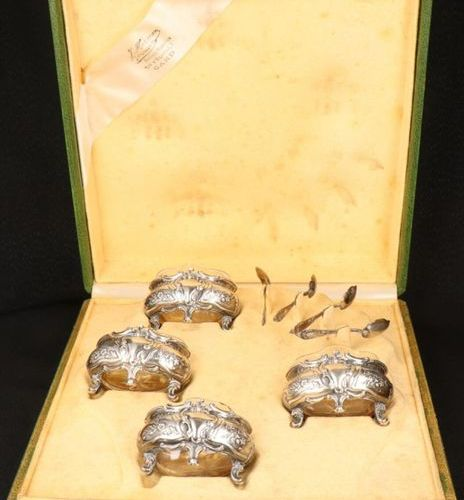 A set of (4) Rococo style silvered salt cellars with spoons in a casette. With s…