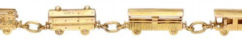 18K. Yellow gold bracelet with locomotive and 5 wagons. 带安全夹。印记:Industria Argent…