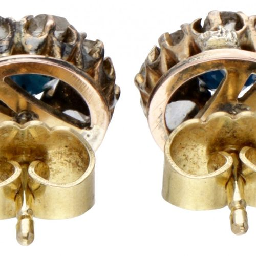 14K. Yellow gold entourage earrings set with approx. 0.48 ct. Natural sapphire a…