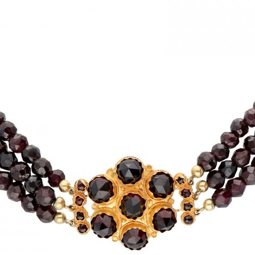 Three row vintage garnet necklace with a 14K. Yellow gold closure set with garne…