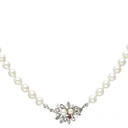 Single strand pearl necklace with a 14K. White gold closure set with pearl and r…