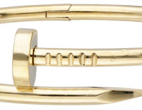 18K. Yellow gold classic Cartier 'Juste un Clou' bangle bracelet. Poinçons : © C…