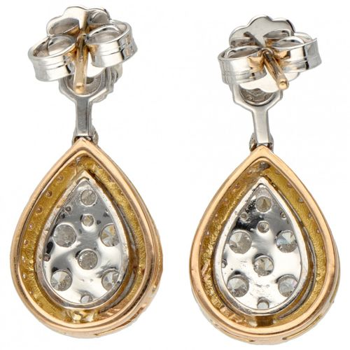 18K. Bicolor gold entourage earrings set with approx. 1.54 ct. Diamond. 印章:750。镶…