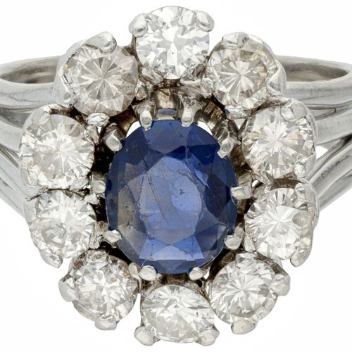 Pt. 850 Platinum entourage ring set with approx. 0.91 ct. Natural sapphire and a…