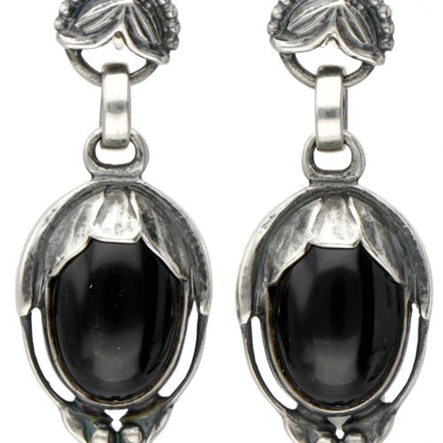 Silver Georg Jensen earrings of the year 2010, set with black agate 925/1000. De…