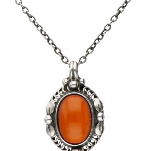 Silver Georg Jensen necklace with pendant of the year 1995, set with amber 925/1…