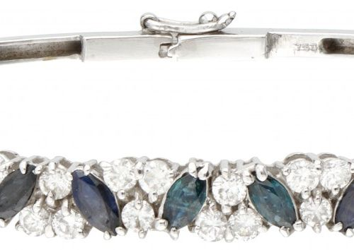 18K. White gold bangle bracelet set with approx. 0.88 ct. Diamond and approx. 0.…