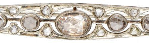 14K. White gold openwork Art Deco brooch set with 15 rose cut diamonds. Poinçons…