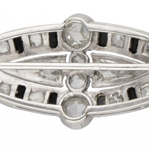 14K. White gold openwork Art Deco brooch set with rose cut diamonds and onyx. Po…