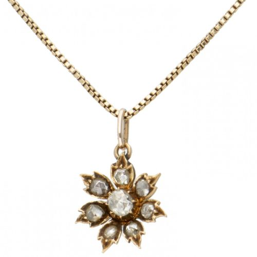 Vintage 14K. Yellow gold necklace and flower shaped pendant set with diamond. 8颗…