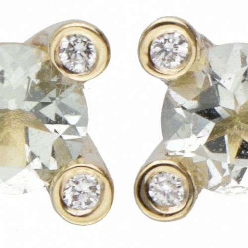 18K. Yellow gold Bron earrings set with approx. 0.72 ct. Aquamarine and approx. …