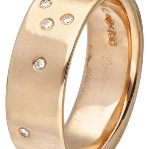 18K. Rose gold Niessing band ring set with approx. 0.04 ct. Diamond. Poinçons : …