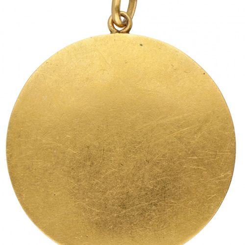 18K. Yellow gold Art Nouveau pendant with an elegant lady set with glass garnet.…