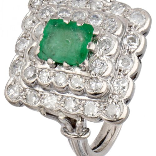 BLA 10K. White gold entourage ring set with approx. 0.96 ct. Diamond and emerald…