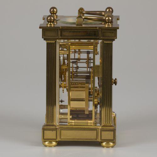 """A Matthew Norman brass so called """"Carriage Clock"""". Avec verre accentué et clé.  …"""