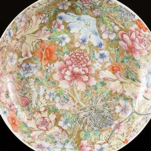 A porcelain plate with mille fleur decor, marked. Qianglong, China, 19th century…