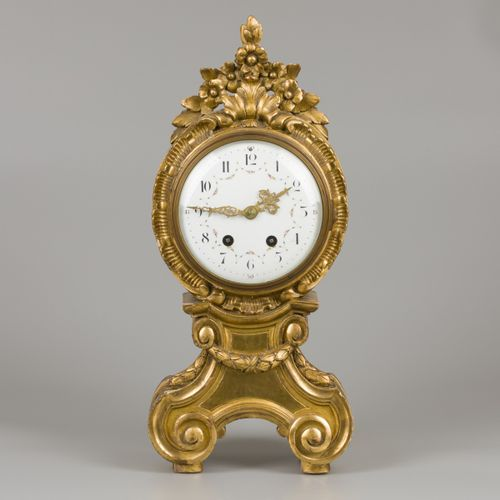 A Louis XV style mantle clock in guiltwood and gesso case, 19th century. 珐琅表盘上的阿…
