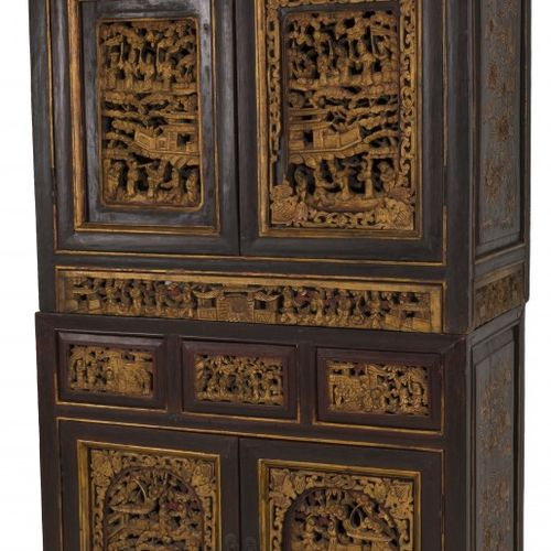 A Chinese bridal cabinet decorated with carvings, China, 20th century. La partie…