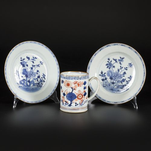 A lot comprised of (2) porcelain plates with floral decoration and a porcelain m…