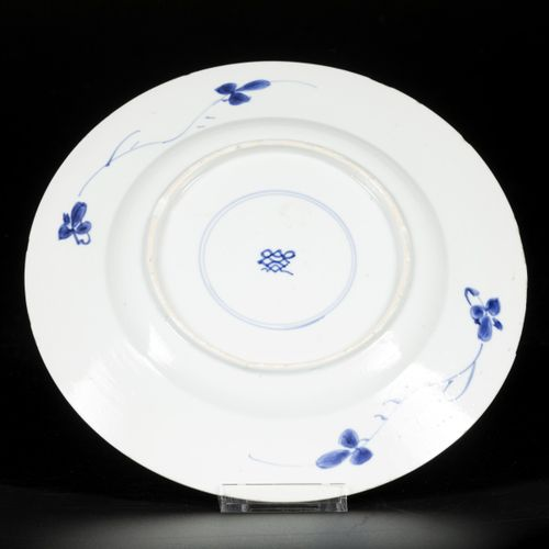 A porcelain plate with 4 compartment outer rim decor, in the centre floral decor…