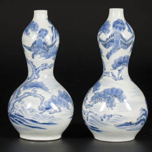 A set of (2) porcelain gourd vases decorated with falcons in a landscape, Japan,…