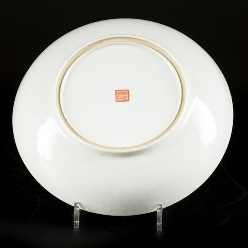A porcelain charger with famille rose decoration, marked Qianglong, China, Repub…