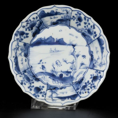 A lot comprising (3) contoured porcelain plates, two with floral decoration, one…