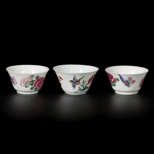 A lot comprising (3) porcelain famille rose cups with butterfly and bird decor, …