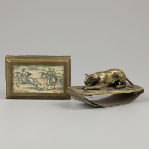 A bronze cast blotter with lurking lioness, together with a copper box for playi…