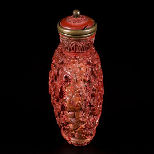 A lacquerwork snuff bottle with floral decoration and ruyi, China, 19th century.…