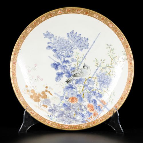 A porcelain charger decorated with a bird on a branch, Japan, 19th century. Diam…
