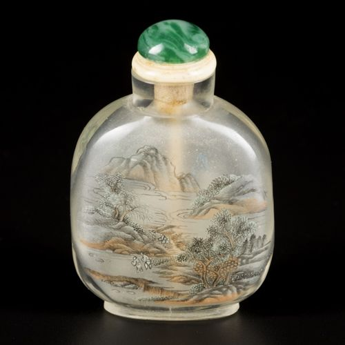 A glass snuff bottle with decoration of figures and a mountain landscape, China,…