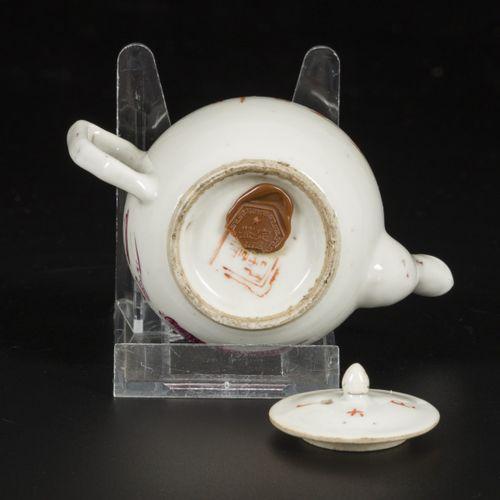 A porcelain teapot with Qianjiang Cai decoration, China, 19th century. Dim. 8 x …
