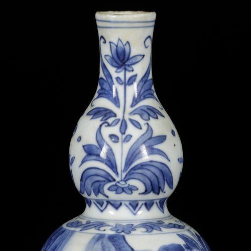 A porcelain gourd shaped vase with decor of figures in garden and tulips, China,…