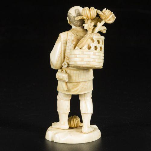 An ivory okimono of a pipe smoking gentleman, Japan, late 19th century. Dim. 14 …