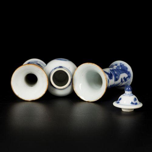 A (3) piece porcelain garniture set (lidded vase and two beaker vases), China, 1…