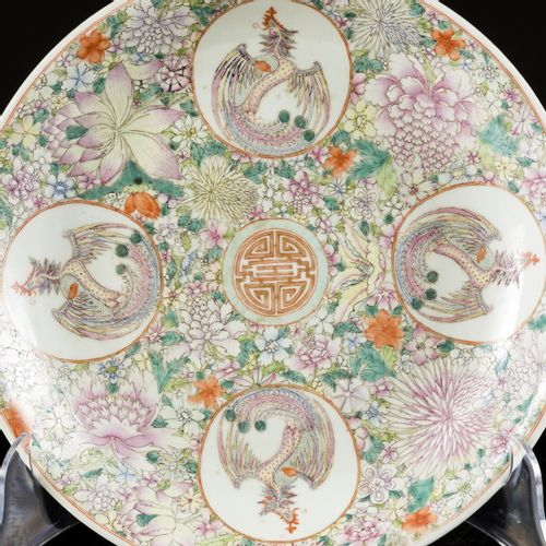 """A porcelain """"mille fleurs"""" charger decorated with phoenixes, marked Qianglong, C…"""