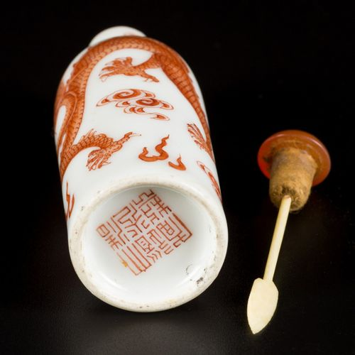 A porcelain snuff bottle with dragon decoration, marked in period, China, Doagoa…