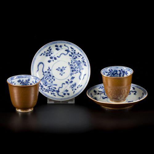 A set of (2) porcelain cups and saucers with floral decoration and capuchin exte…
