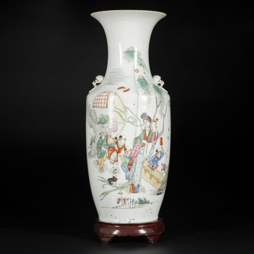 A porcelain Qiangjiang Cai vase with decoration of zotjes playing near a lice, C…
