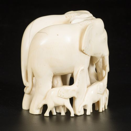 An ivory carving depicting a group of elephants, DRC, ca. 1920/30. Dim. 11,5 x 8…