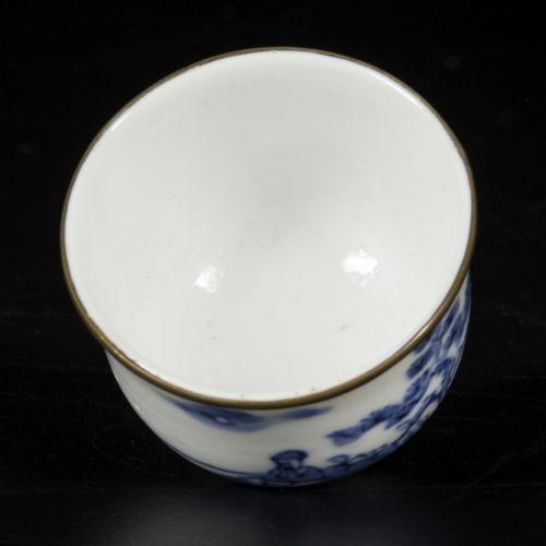 A porcelain cup with landscape decoration and metal rim lip, Vietnam, 19th centu…