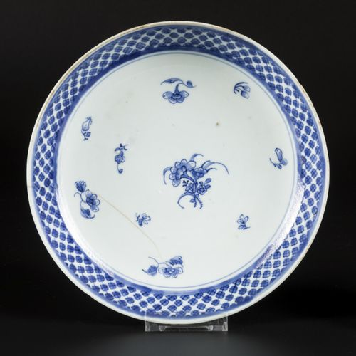 A deep porcelain plate and one saucer with floral decoration, China, 18th centur…