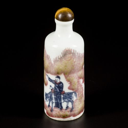 A porcelain iron red snuff bottle decorated with street artists, marked Yongzhen…